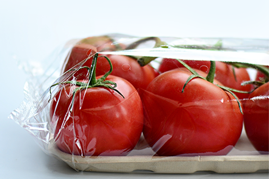 Tomatoes wrapped in plastic to preserve freshness