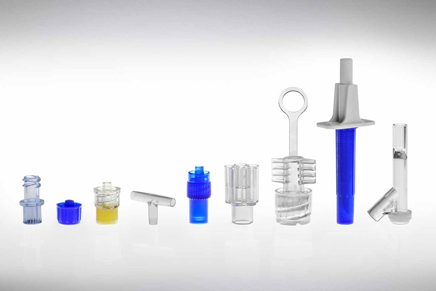 An assortment of plastic components by Adam Spence Corporation