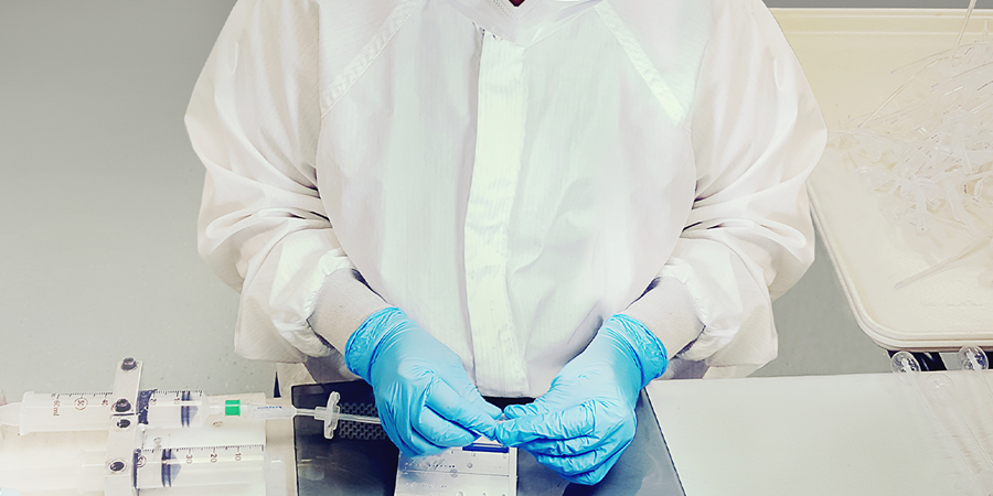 A Xeridiem technician working with silicone components